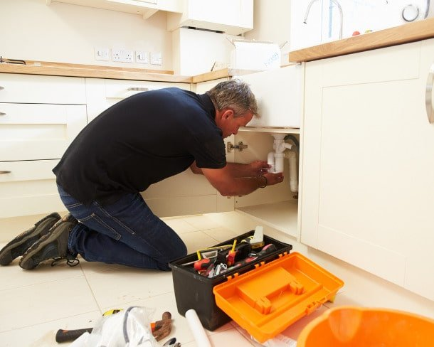 male-plumber-fixing-a-kitchen-sink-picture-id489303932-min