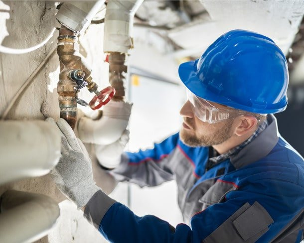 male-worker-inspecting-valve-picture-id1204813771-min