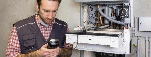 plumber-repairing-a-condensing-boiler-picture-id932472370-min