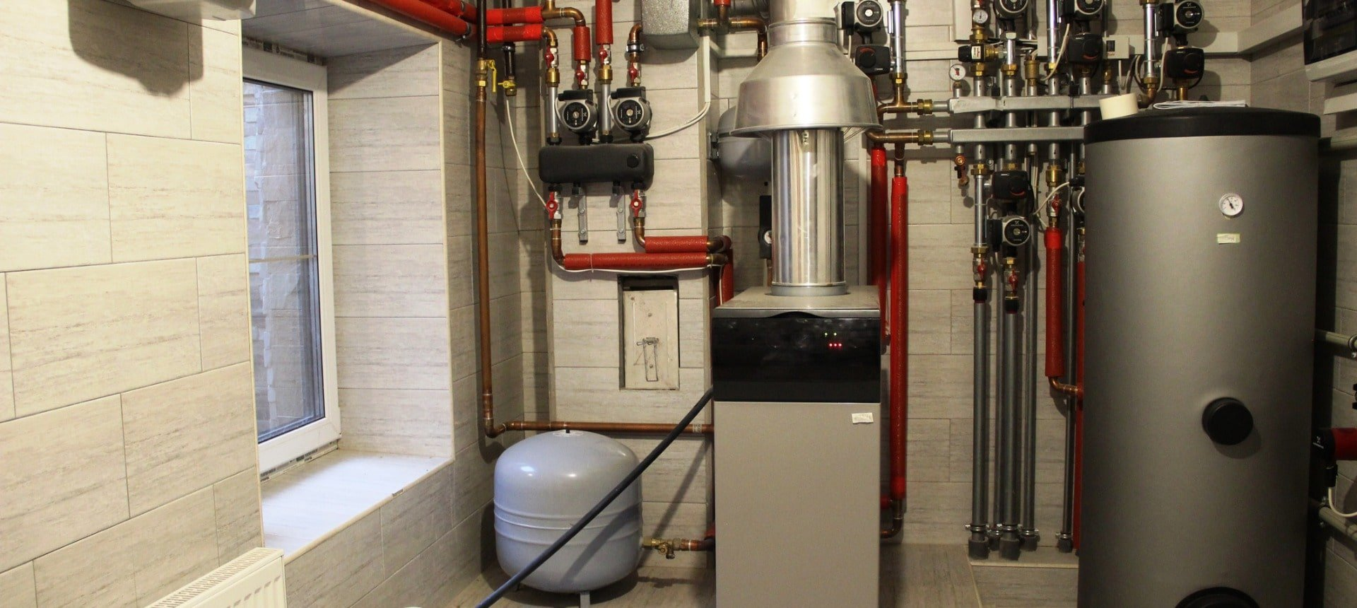 house-boiler-water-heater-expansion-tank-and-other-pipes-newmodern-picture-id1165699955-min