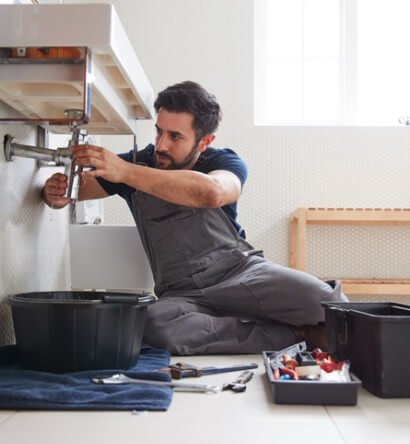 male-plumber-working-to-fix-leaking-sink-in-home-bathroom-picture-id1205228815 (1)