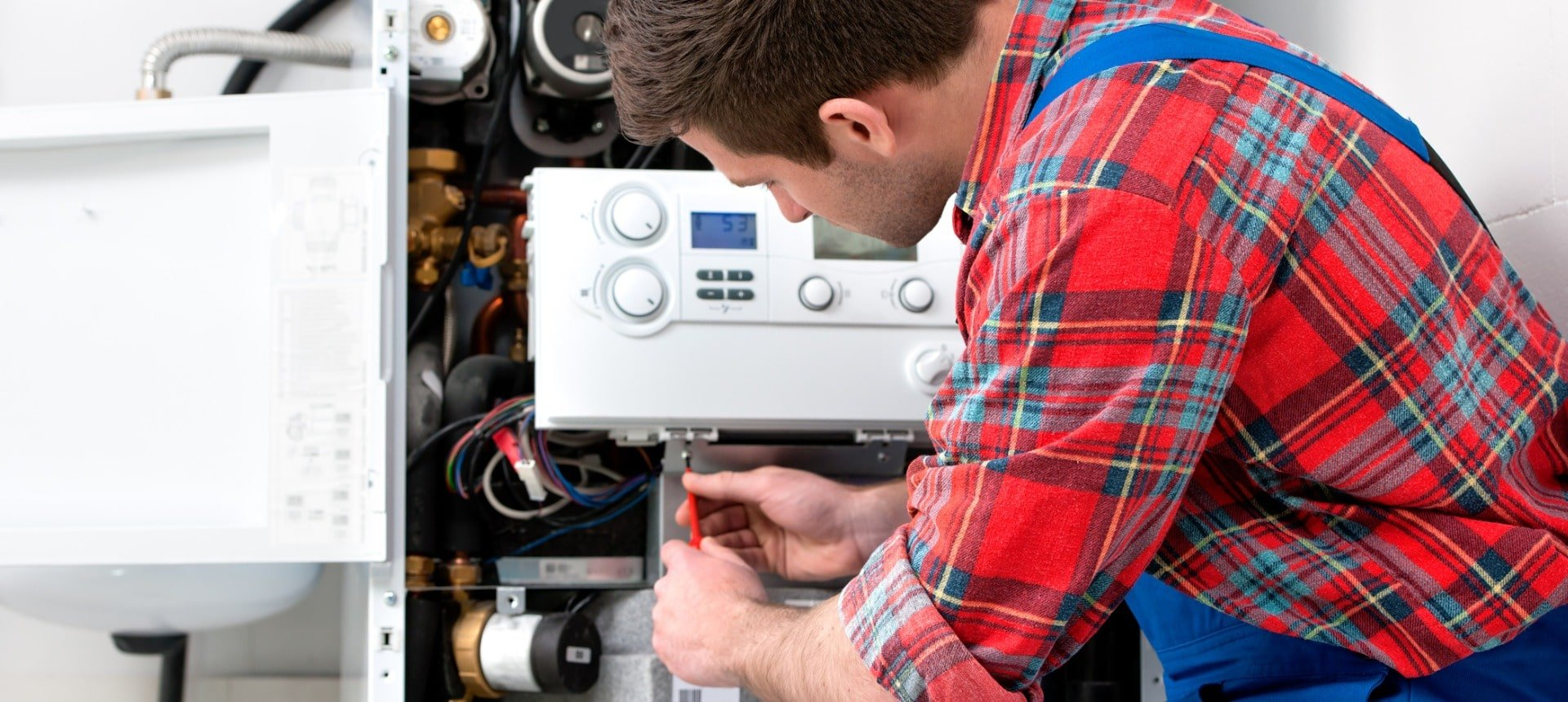 technician-servicing-heating-boiler-picture-id482115611-min