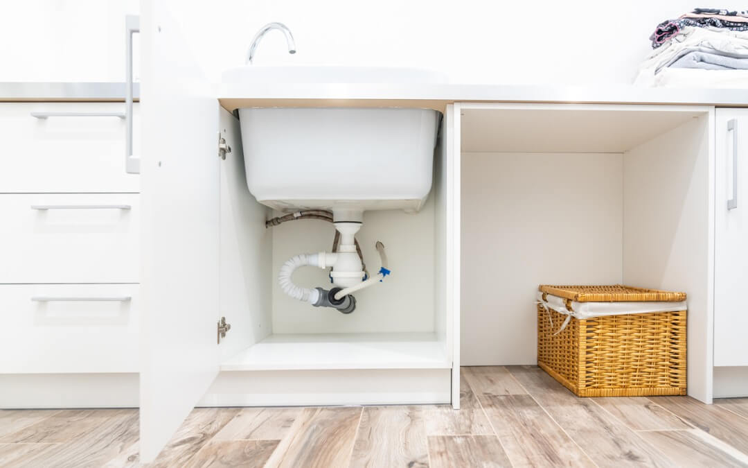 under-the-sink-view-in-laundry-room-picture-id1192154232 (1)