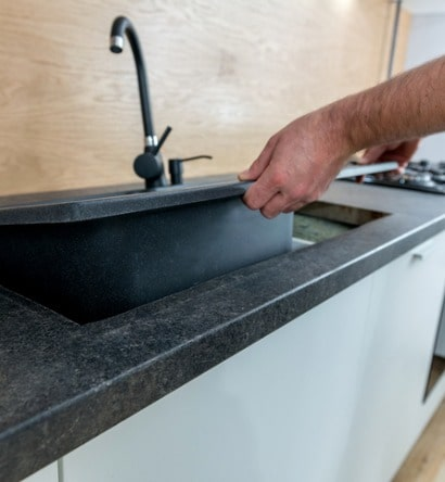 installing-a-new-ceramic-sink-in-kitchen-picture-id1142403415-min
