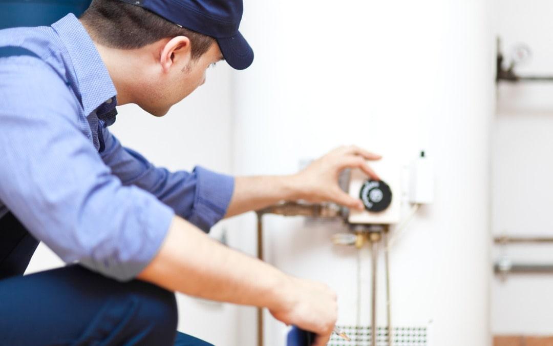 technician-repairing-an-hotwater-heater-picture-id178425815-min