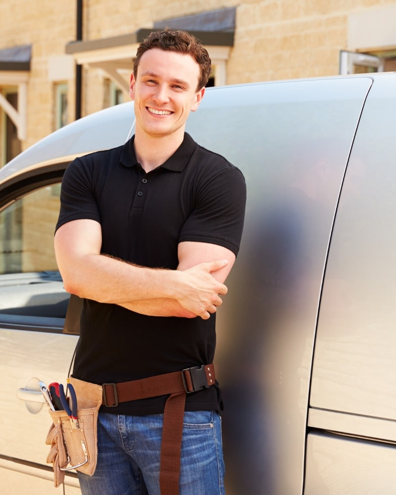 portrait-of-a-young-tradesman-by-his-van-picture-id488756852-min